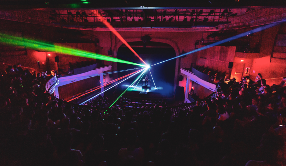 Laser beams shooting all directions in theatre space