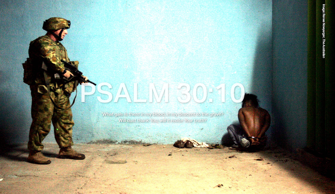 A youth detained under suspicion of burning houses belonging to pro Prime Minister Alkatiri supporters is held at gun point by an Australian soldier in East Timor in 2006.