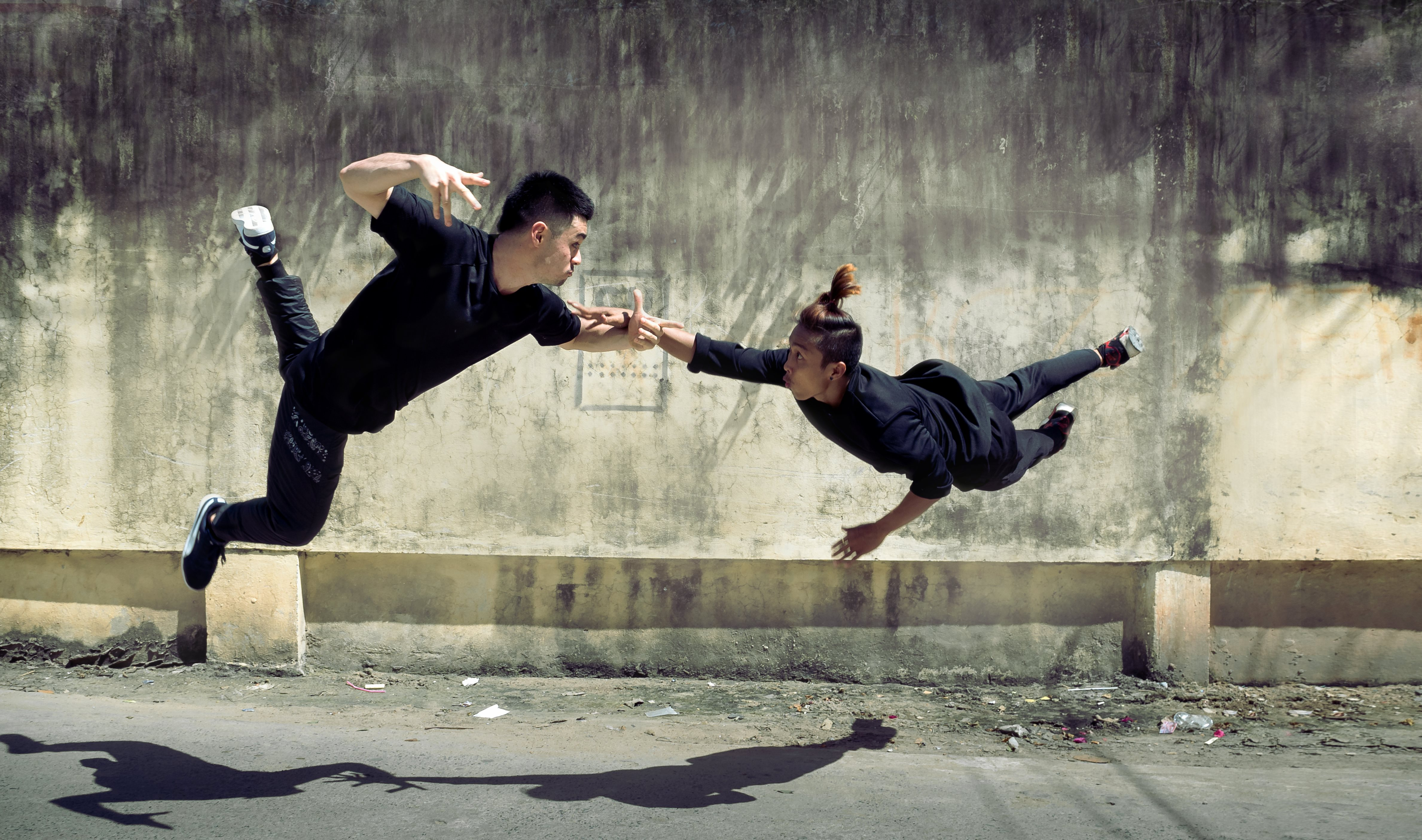 Two dancers mid air